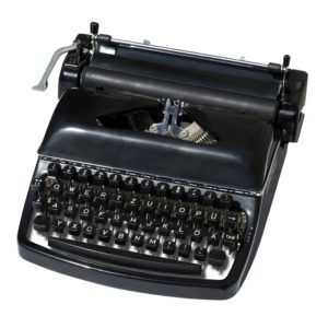 Vintage typewriter isolated on a white.